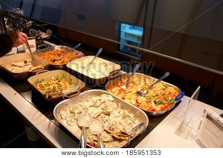 TORONTO, CANADA - JAN 28th, 2017: Air Canada Maple Leaf Lounge at YYZ airport International, eating area with a buffet with a choice of hot meals, airport interior for frequent flyer.