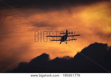 AIRPLANE - The plane flies among dense clouds