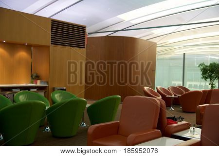 TORONTO, CANADA - JAN 28th, 2017: Air Canada Maple Leaf Lounge at YYZ airport International, seating area with colored leather chairs, airport interior for frequent flyer.