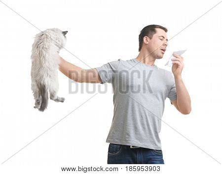 Animal allergy concept. Handsome man with cat on white background