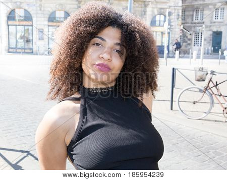 a beautiful mestizo woman with curly hair