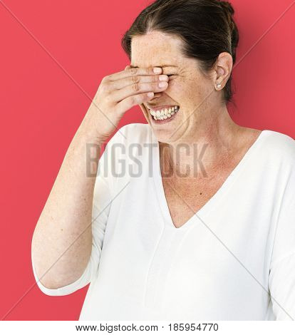 A Caucasian Woman giggling and laughing