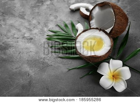 Fresh melted coconut oil in half of nut on table