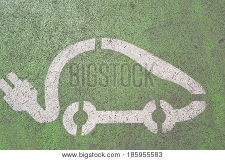 Paint On The Floor That Indicates A Parking Space Reserved For Electric Cars