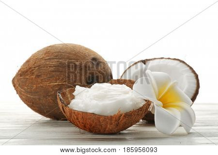 Composition with coconut oil in shell on white background