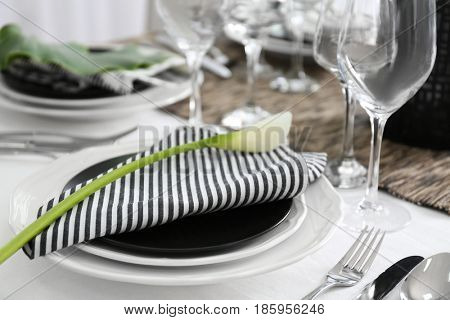 Dishware with floral decoration on table