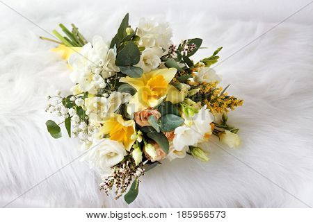 Beautiful bouquet with freesia flowers on furry cloth