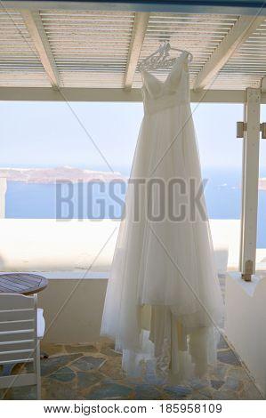 SANTORINI, GREECE - CIRCA AUGUST, 2015: wedding dress hanging in Andromeda Villas hotel. Andromeda Villas is a hotel are situated in Imerovigli, Santorini island.