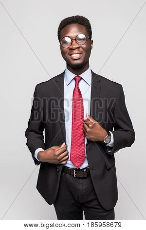 Studio Fashion Portrait Of A Handsome Young African American Businessman Wearing A Black Suit And Ti