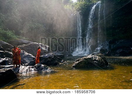SIEM REAP, CAMBODIA - JANUARY 27, 2015: Unidentified group of monk in Phnom Kulen waterfall in Kulen National Park, Siem Reap Province, Cambodia.