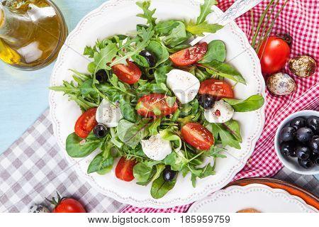 Caprese salad with tomatoes and mozzarella
