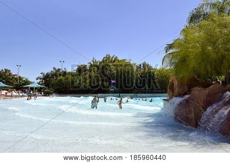 Aquatica water park Orlando Florida USA - October 23 2016: Tourists in Big Surf Shores adventure play area in Aquatica water park