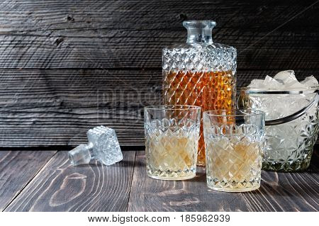 Glass And Bottle Of Hard Liquor Like Scotch, Bourbon, Whiskey Or Brandy On Wooden Background With Co