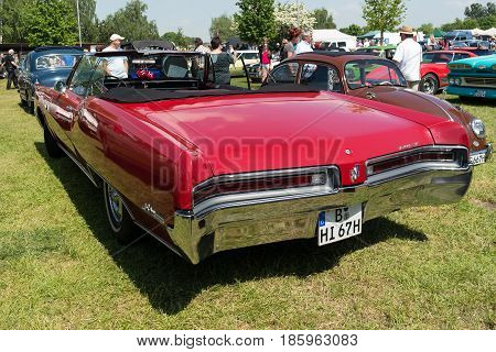 PAAREN IM GLIEN GERMANY - MAY 19: Full-size car Buick Le Sabre Custom 1967 Cabrio back view