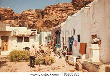 BADAMI, INDIA - FEB 8, 2016: People living in small village houses on narrow street of traditional town on February 8, 2017. Population of Karnataka is 62000000 people