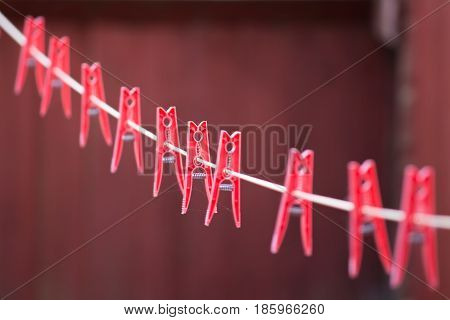 Red Pegs In A Row On A Washing Line