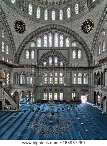 Istanbul, Turkey - April 20, 2017: Interior of Nuruosmaniye Mosque, an Ottoman Baroque style mosque completed in 1755, with a huge dome & many colored stained glass windows located in Fatih district