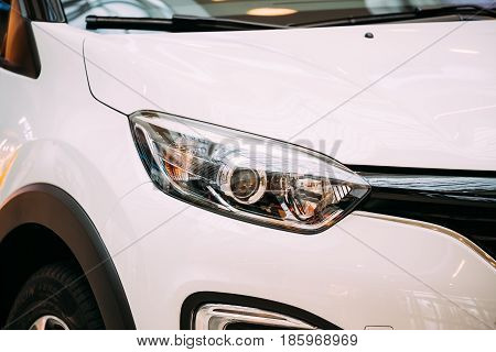 Minsk, Belarus - November 04, 2016: Close The Right Headlight Of New White Color Renault Captur Car. The Compact SUV
