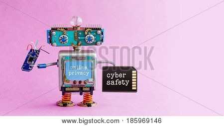 Cyber safety online privacy robotic concept. System administrator robot toy with memory card chip circuit. Steampunk cyborg, blue head. Alert message interface monitor. Pink background. Copy space photo