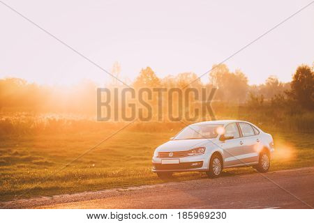 Gomel, Belarus - August 25, 2016: Volkswagen Polo Sedan Car Parking On A Roadside Of Country Road During Sunset Or Sunrise