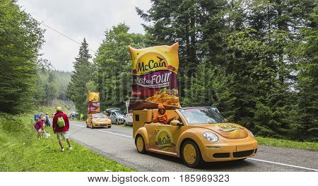 Col de Platzerwasel France - July 14 2014: McCain vehicles during the passing of the Publicity Caravan in front of the audience on the road to Mountain Pass Platzerwasel in Vosges mountains in the stage 10 of Le Tour de France on July 14 2014. Before the
