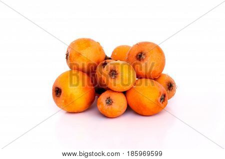 Medlar Or Loquat Fruits Isolated On A White Background