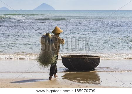 Unidentified Fishermen Is Working On The Beach In Nha Trang, Vietnam