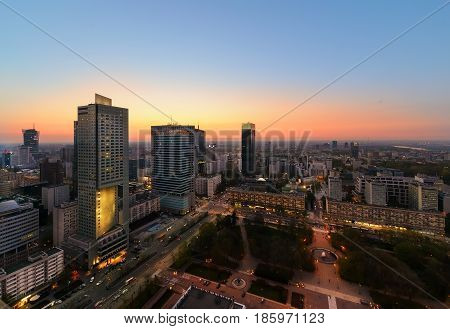 Warsaw city with modern skyscraper after sunset Poland Europe.
