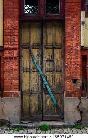 The Wooden Door Of Dilapidated Building In A City