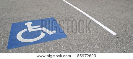Handincapped designated parking space in a parking lot.
