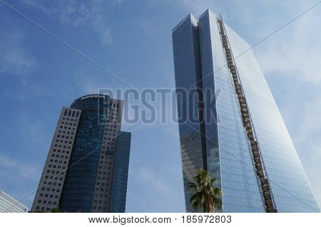 TEL-AVIV, iSRAEL - DECEMBER 26 : Skyscrapers near modern open air commercial center and park Sarona, German templer colony in Tel-Aviv, Israel
