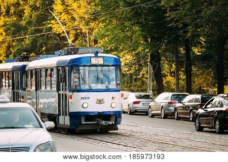 Riga, Latvia - July 2, 2016: Public old retro tram with the number of the fifth route on summer street Siegfried Anna Meierovics Boulevard in Riga, Latvia