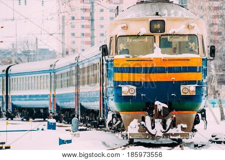 Old Diesel locomotive on Railway In Cold Snowy Winter Day.