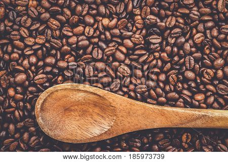 coffee beans and wooden spoon on the table background