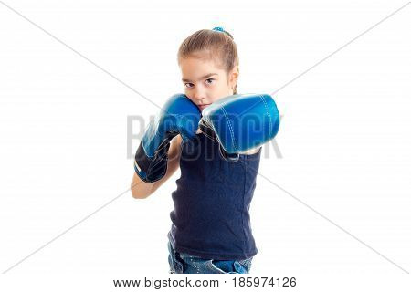 girl stretched forth her hands in large adult boxing gloves is isolated on a white background
