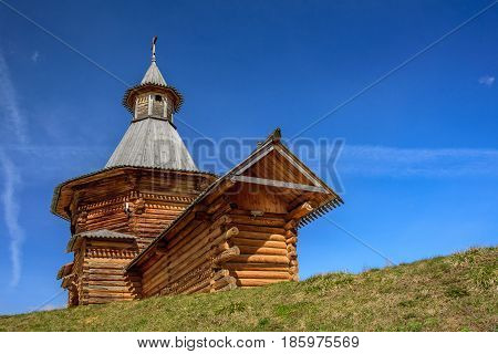 Spring view of the wooden Travel Tower of the Nikolo-Korelsky Monastery in the Kolomenskoye Museum at sunny day, Moscow, Russia