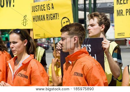 BERLIN - JUNE 19 2013: Amnesty International activists protest at Potsdamer Platz near the Ritz-Carlton because of his state visit to Germany by US President Barack Obama