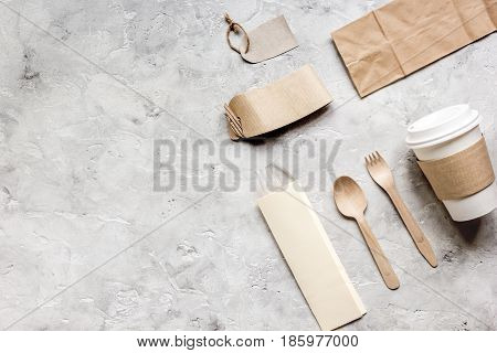 paper bags and tea bag for take away set on restourant stone table background top view space for text