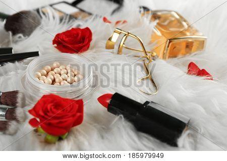 Cosmetics on furry background, closeup