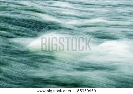 Background texture of a greenish blue hue from the water flow