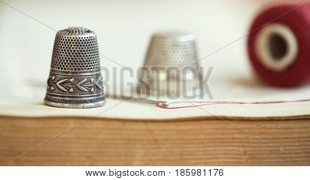 Hobby diy concept - website banner of old vintage thimble