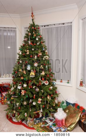 Traditional Christmas Tree With Gifts Under It