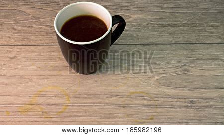 Black and white Coffee cup with coffee stain on wooden board