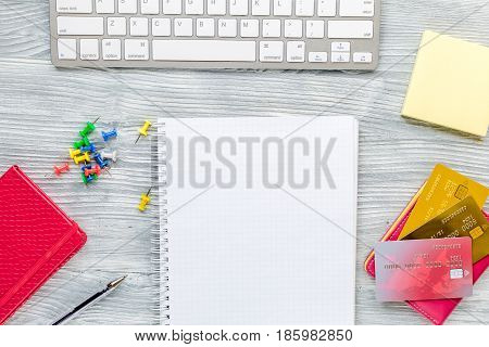 admission fee-paying school with credit cards, keyboard and notebook on white desk background top view mock up