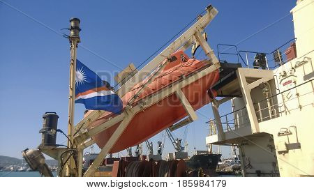 A Lifeboat In Case Of An Accident In The Port Or On A Ship. The Orange Boat