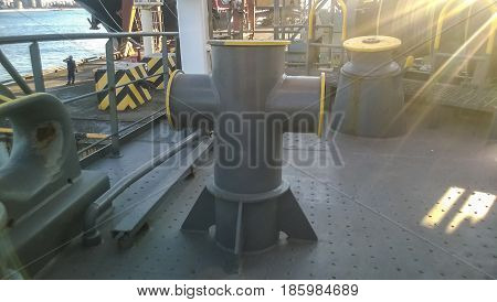 Mooring Bollard On The Decks Of An Industrial Seaport.