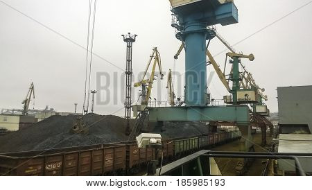 Cargo Industrial Port, Port Cranes. Loading Of Anthracite. Trans