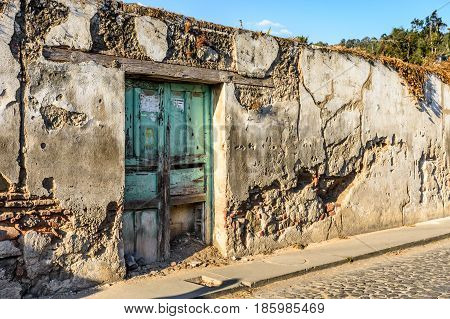 Antigua, Guatemala - March 19 2017: Old crumbling wall of abandoned house in colonial city & UNESCO World Heritage Site of Antigua, Guatemala, Central America