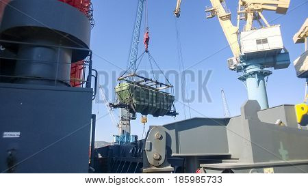 Moving Freight Railway Car In The Port By A Port Crane. Cargo Lifting Operations. Industrial Port.