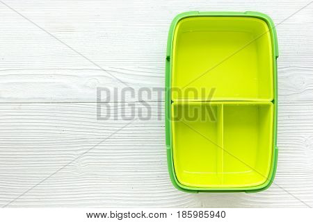 homemade lunch with green lunchbox on wooden table background top view mockup